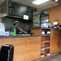 Photo taken at Zesto's Pizzeria by Redmark N. on 8/10/2016