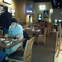 Photo taken at Boston Pizza by Morgan T. on 10/23/2012