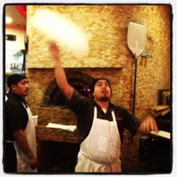 Photo taken at Urban Crust Wood Fired Pizza by Victoria H. on 12/27/2012