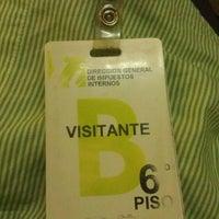 Photo taken at Sede Central Dirección General de Impuestos Internos (DGII) by Hamilton F. on 2/13/2014
