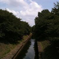 Photo taken at 尾崎橋 by tatsuya h. on 8/7/2011