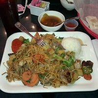 Photo taken at Umami Mongolian Grill by Jamie R. on 8/14/2011