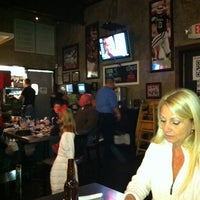 Photo taken at Louie's Grill & Bar by Michael F. on 12/9/2011