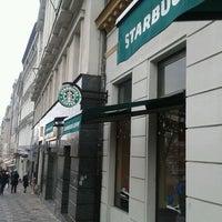 Photo taken at Starbucks by Alexander S. on 1/1/2012