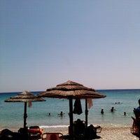Photo taken at Glikoriza Beach by Stelios L. on 7/22/2012