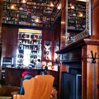 Photo taken at The Library at Hudson Hotel by Christopher R. on 3/26/2012