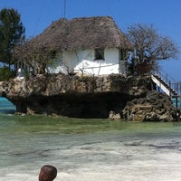 Photo taken at The Rock Restaurant Zanzibar by Julian V. on 7/31/2011