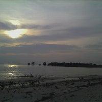 Photo taken at Pantai Kelanang by Ameer F. on 9/10/2011