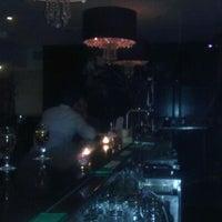 Photo taken at Stella Manhattan Bistro by Atif S. on 4/12/2012
