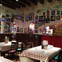 Photo taken at Buca Di Beppo by Ruben P. on 4/26/2012