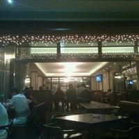 Photo taken at Bizar Bar & Dinner by Joana G. on 7/20/2012