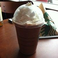 Photo taken at Starbucks by Leslie M. on 3/28/2012