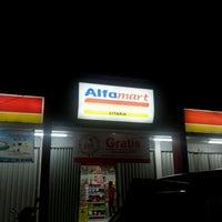 Photo taken at AlfaMart Lemah Abang by Rey M. on 1/14/2012
