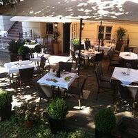 Photo taken at FLAVOUR Weinbar Restaurant by Michael L. on 8/26/2011