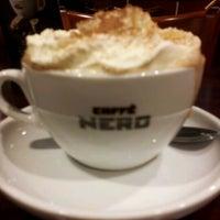 Photo taken at Caffè Nero by Penelope B. on 1/18/2012