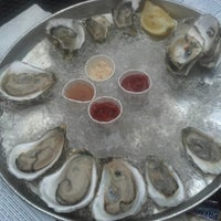 Photo taken at Thames Street Oyster House by Brian L. on 8/3/2012