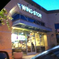 Photo taken at Wingstop by Jaida M. on 5/29/2012