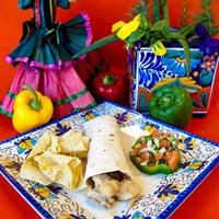 Photo taken at La Popular Tamale House by La Popular T. on 1/19/2012