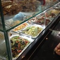 Photo taken at Singh's Roti Shop by Natalie G. on 5/20/2012