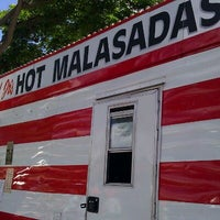 Photo taken at Leonard Jr.'s Malasadas Mobile by Neal Q. on 9/27/2011