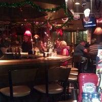 Photo taken at Applebee's Neighborhood Grill & Bar by Raptor N. on 12/21/2011
