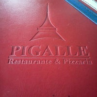 Photo taken at Pigalle Restaurante e Pizzaria by Geny S. on 1/22/2012