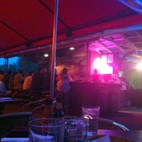 Photo taken at Atomic Cafe by Elizabeth F. on 8/11/2012