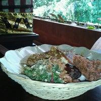 Photo taken at Babi Guling Ibu Oka by Deddy R. on 2/13/2012