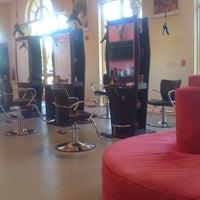 Photo taken at E Geovanni Salon by Katie Q. on 7/21/2011