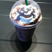 Photo taken at Starbucks by Katie B. on 8/1/2011