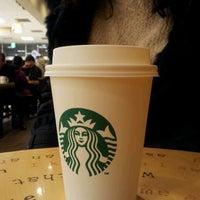 Photo taken at Starbucks by 김준우 on 1/7/2012