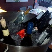 Photo taken at Bacaro Wine Lounge by Jennifer D. on 7/13/2012