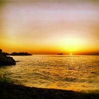Photo taken at Kapuz Plajı by 'F Y. on 8/21/2012