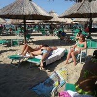 Photo taken at Nettuno Beach Club by Paolo N. on 7/14/2012