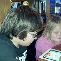 Photo taken at Applebee's Neighborhood Grill & Bar by Karen R. on 8/4/2012
