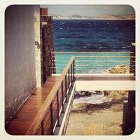 Photo taken at Grand Resort Lagonissi by Phoebus I. on 8/23/2012