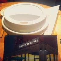 Photo taken at Starbucks by namsoo c. on 3/9/2012