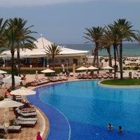 Photo taken at Mövenpick Resort & Marine Spa Sousse by Ruslan B. on 6/16/2012
