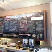 Photo taken at Mick's Karma Bar by Alex R. on 3/21/2012