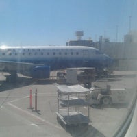 Photo taken at Gate B58 by Patrick H. on 6/21/2012