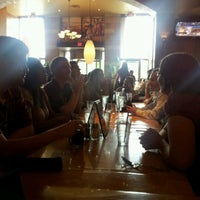 Photo taken at BJ's Restaurant and Brewhouse by Chris J. on 7/12/2012