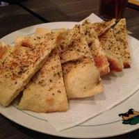 Photo taken at Pisa Kafe by Eric S. on 12/27/2012