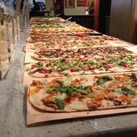 Photo taken at Jules Thin Crust Pizza by Maureen G. on 9/22/2013