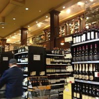 Photo taken at Wine Library by Maureen G. on 12/8/2012
