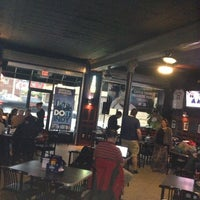 Photo taken at Front Page Sports Bar & Grill by Ben R. on 4/16/2013