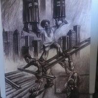 Photo taken at mel's custom picture framing by Ebony J. on 11/18/2012