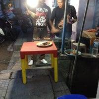 Photo taken at Warung Makan Sukses (Spesial Sate Babi) by Inge S. on 2/15/2014