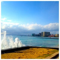 Photo taken at Waikiki Beach Walls by kelli on 3/14/2013