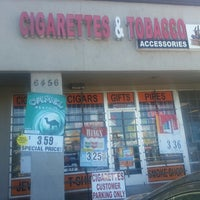 Photo taken at ciggarette and tobacco accessories by Shela H. on 9/23/2013