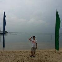 Photo taken at Waterfront Beach @ Hariss Resort by Justin G. on 10/7/2012